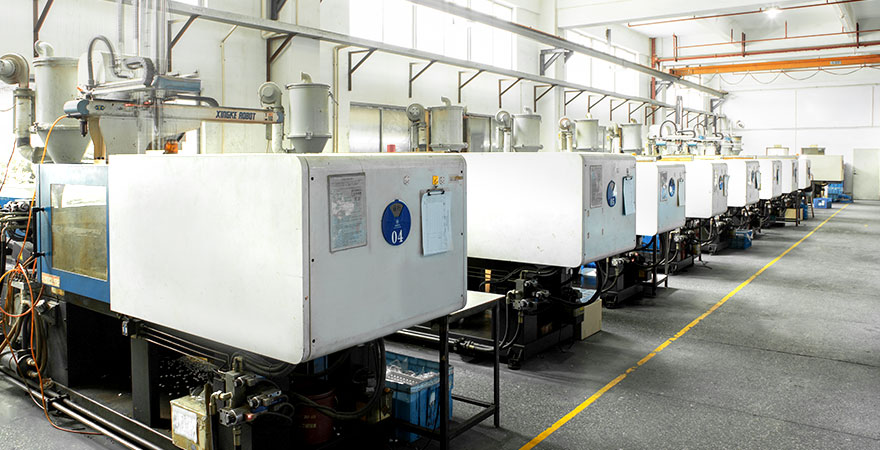 an clean injection workshop with several injection machines